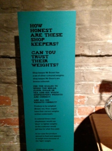 Interactive exhibit weighing goods.